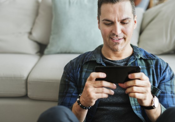 white-man-playing-game-in-mobile-phone-PP9YGAR